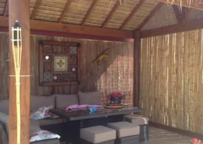 Bali thatch hut with bamboo screen