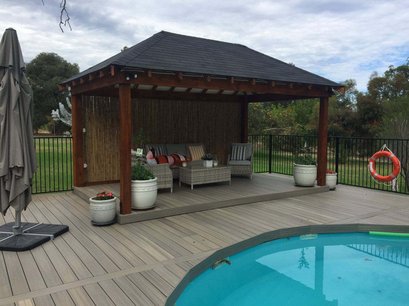 Synthetic decking with pool